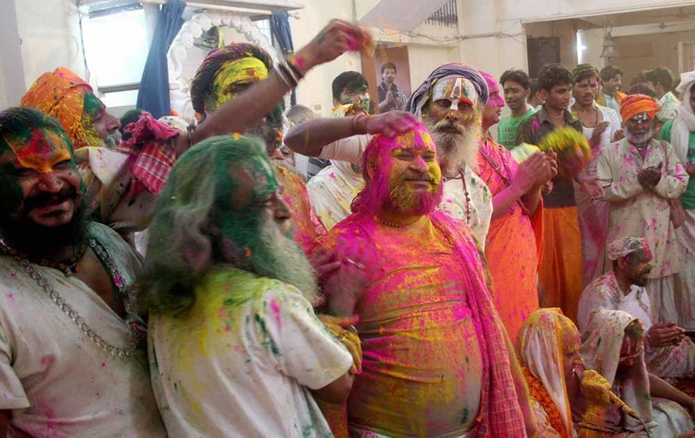 Sadhus playing Holi at a Mutt in Varanasi.