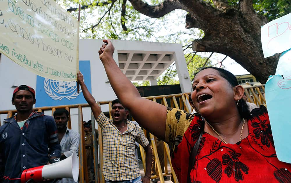 Sri Lankan government supporters from the former northern war zone area wave national flags and shout protest slogans outside the UN office in Colombo, Sri Lanka.