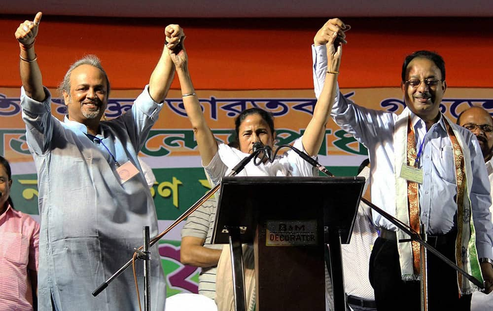 Trinamul Congress Supremo Mamata Banerjee with party candidates Soumitra Roy (North Malda) and Dr. Mouzzen Hossen(South Malda) during an election campaign rally in Malda.