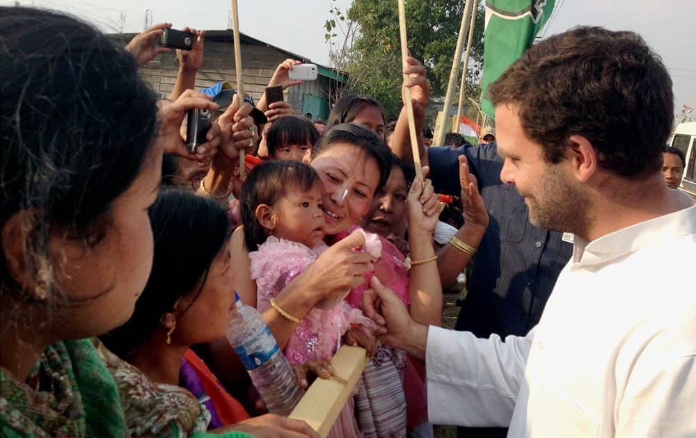 Congress vice president Rahul Gandhi meets people during an election campaign rally in Imphal, Manipur.