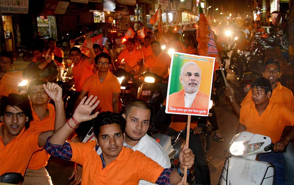 BJP supporters participate in a bike rally to support party`s candidate Rao Inderjit Singh, in Gurgaon.