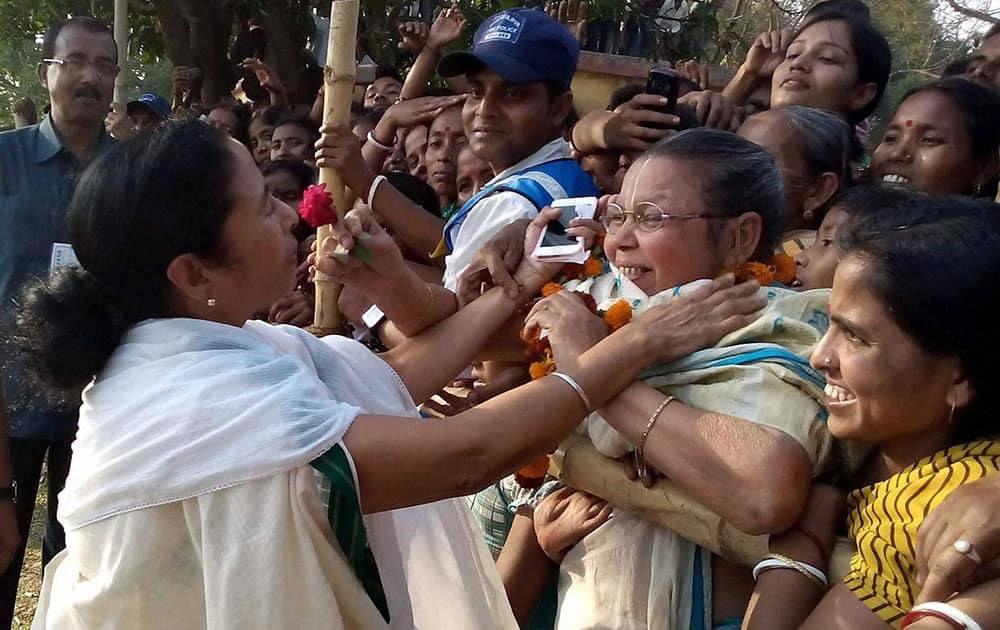 West Bengal Chief Minister and Trinamool Congress Supremo Mamata Banerjee meeting local people during party workers convention ahead of Lok Sabha election at Durgapur near Raiganj in North Dinajpur District of West Bengal.