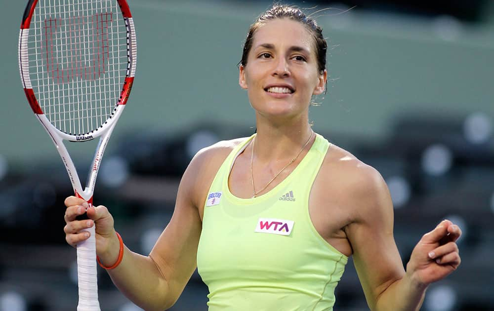 Andrea Petkovic, of Germany, dances for the crowd after defeating Maria-Teresa Torro-Flor, of Spain, 6-3, 6-4 during the Sony Open tennis tournament, in Key Biscayne, Fla.