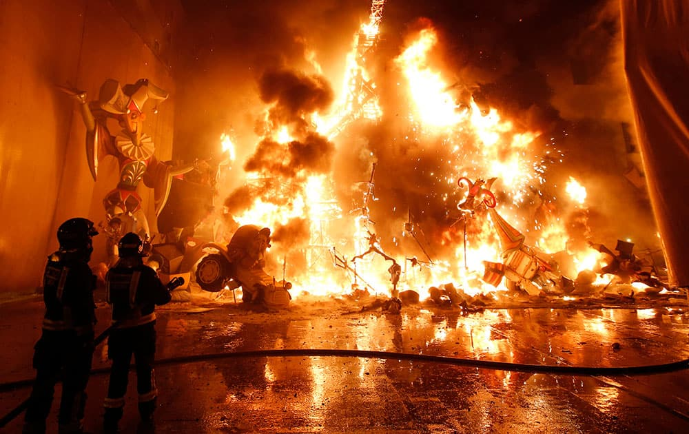 Satirical sculptures burn during the traditional Fallas festival in Valencia, Spain. Every year the city of Valencia celebrates the ancient