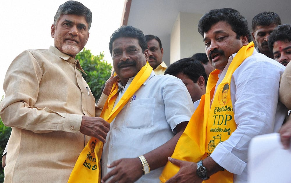 TDP chief N Chandrababu Naidu welcomes Singireddy Harivardhan Reddy along and his supporters who joined TDP in Hyderabad.