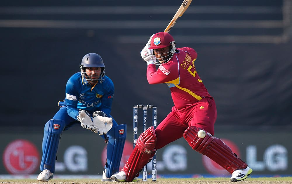 West Indies` batsman Dwayne Smith prepares to play a shot as Sri Lanka`s wicketkeeper Kumar Sangakkara takes his position during their ICC Twenty20 Cricket World Cup warm up match in Dhaka, Bangladesh.