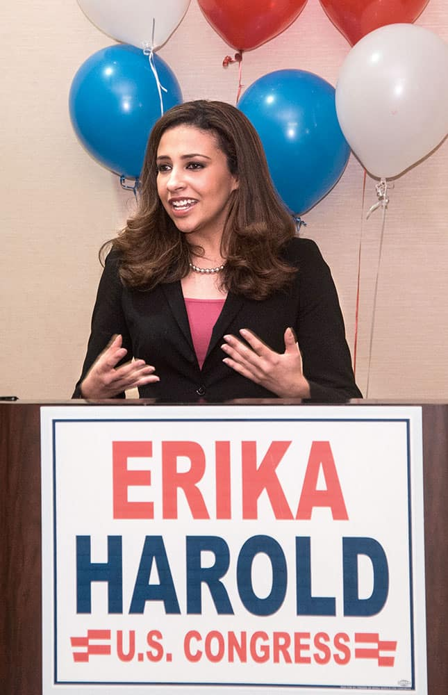 Erika Harold, Republican primary candidate for the13th Congressional District of Illinois, talks to supporters at the Hilton Garden Inn in Champaign, Ill.