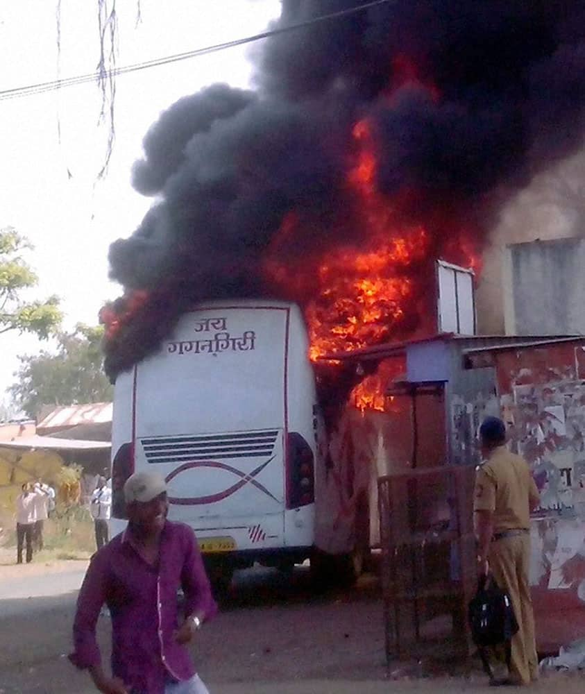 Mob set bus ablaze after the death of a couple in a road accident in Karad, Maharashtra.