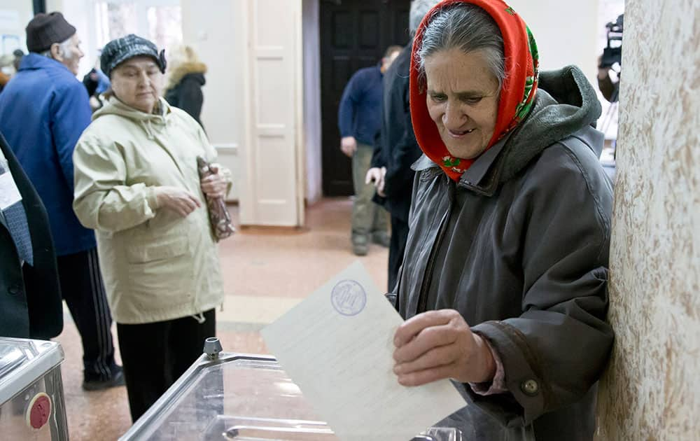 A woman casts her ballot in the Crimean referendum in Simferopol, Ukraine.