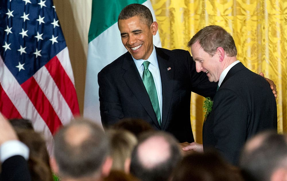 President Barack Obama, left, shakes hands with Irish Prime Minister Enda Kenny, during a St. Patrick's Day reception in the East Room of the White House in Washington.