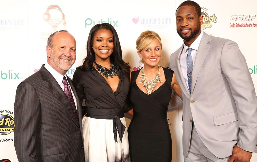 Ron Book, Chairman of Lauren`s Kids, Gabrielle Union, Lauren Book, Founder and CEO of Lauren`s Kids and Dwyane Wade, of the Miami Heat, attend the 8th Annual Reid & Fiorentino Call of the Game Dinner Presented by Publix at the Seminole Hard Rock Hotel & Casino in Hollywood, Fla.