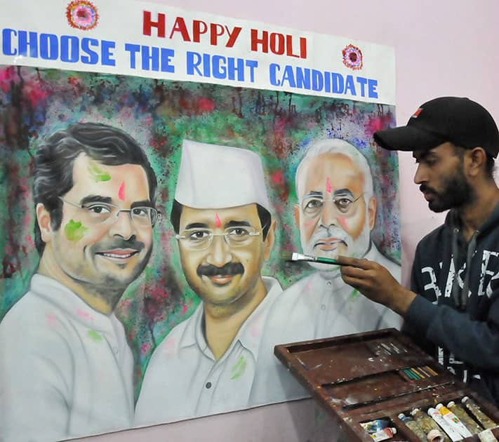 A painter makes a portrait of Prime Ministerial frontrunners Rahul Gandhi, Arvind Kejriwal and Narendra Modi with a message.