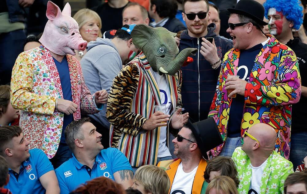 England fans, some wearing masks of a pig and an elephant, wait for the start of the Six Nations Rugby Union match between Italy and England at Rome`s Olympic stadium.