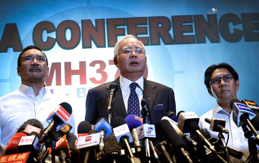 Malaysian Prime Minister Najib Razak, Malaysia`s minister for transport Hishamuddin Hussein and director general of the Malaysian Department of Civil Aviation, Azharuddin Abdul Rahman, delivers a statement to the media regarding missing Malaysia Airlines jetliner MH370, Saturday, March 15, 2014 in Sepang, Malaysia.