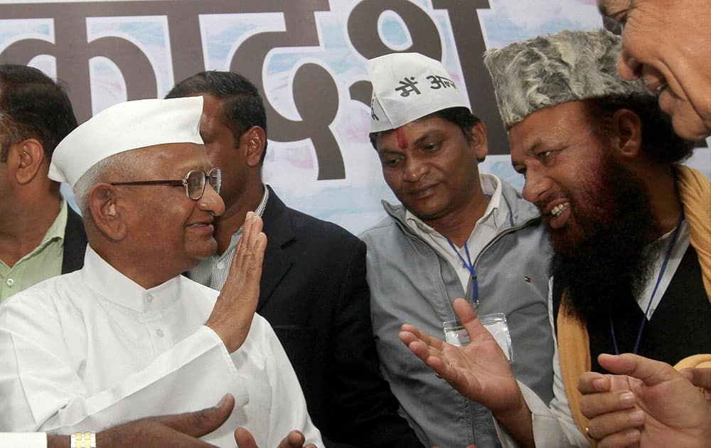 Social activist Anna Hazare meeting supporters after a function in New Delhi.