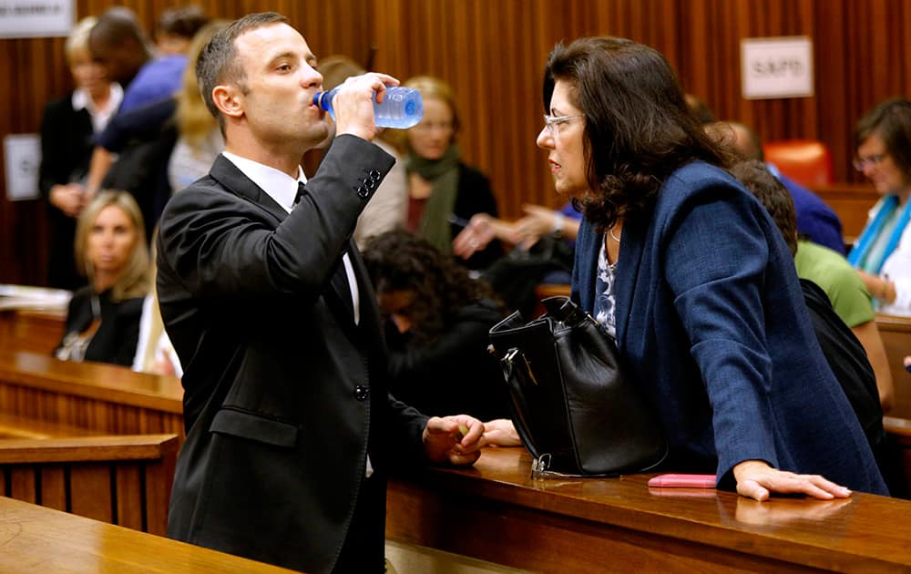 Oscar Pistorius drinks water in court in Pretoria, South Africa, prior to his tenth day in court.