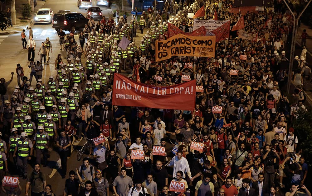 Demonstrators march holding a banner that reads in Portuguese `There wont be Cup`, protest against money spent on the World Cup preparations in Sao Paulo, Brazil.