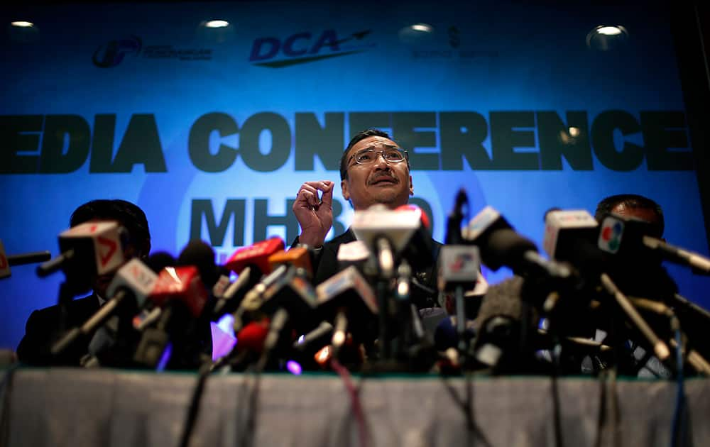 Malaysia`s Minister of Transport Hishamuddin Hussein takes questions from the media during a press conference about the missing Malaysia Airlines jetliner MH370 in Sepang, Malaysia.
