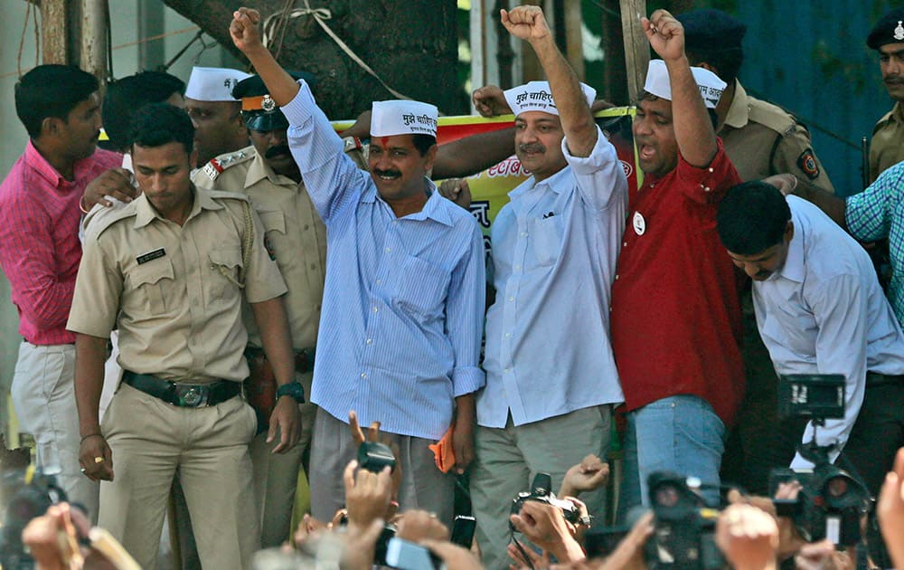 Leader of Aam Aadmi Party, or Common Man Party, and anti-graft activist Arvind Kejriwal, center, shouts slogans during an election rally in Mumbai, India.