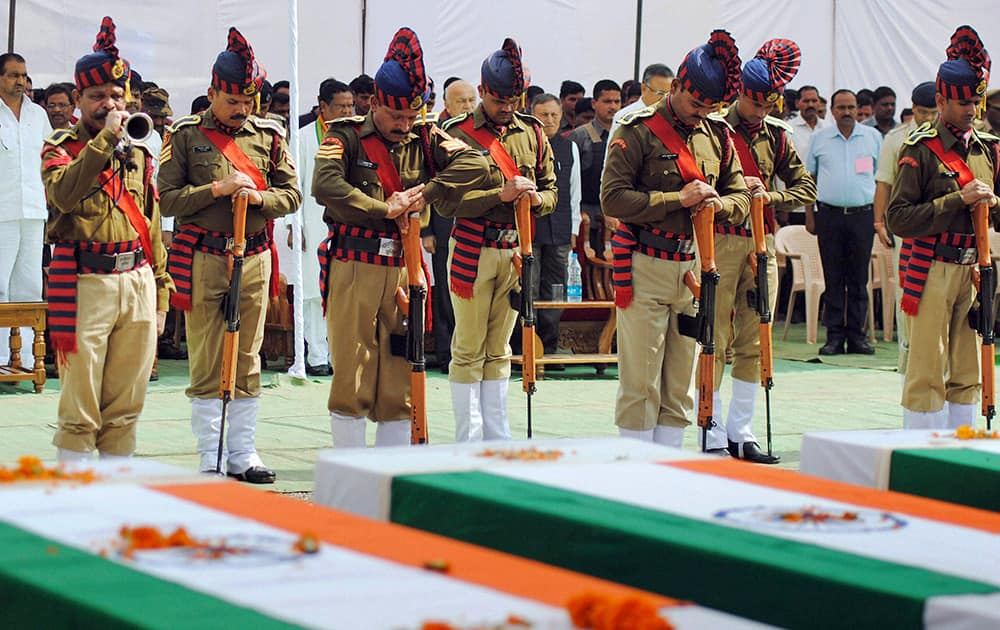 Indian security personnel pay homage to paramilitary soldiers killed in an ambush by Maoist rebels, in Jagdalpur, in the eastern Indian state of Chhattisgarh.