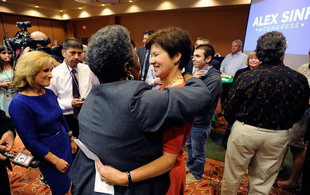 Congressional candidate Alex Sink, center, greets a supporter after giving her concession speech  in St. Petersburg, Fla.