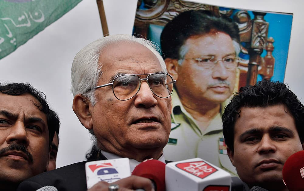 Ahmed Raza Kasuri, a lawyer of former Pakistani President Pervez Musharraf talks to the media outside a court in Islamabad, Pakistan. A defense lawyer says a Pakistani court trying Musharraf has delayed his indictment after authorities warned about an al-Qaida and Taliban plot on his life.