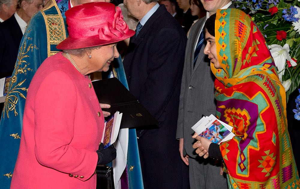 Britain`s Queen Elizabeth II meets with Pakistani school girl education advocate Malala Yousafzai as they attend the Commonwealth Observance day multi-faith celebrations at Westminster Abbey, London.