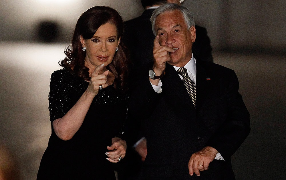 Argentine President Cristina Fernandez, left, chats with Chile`s President Sebastian Pinera, before a group photo of visiting dignitaries at the Moneda Palace in Santiago, Chile.
