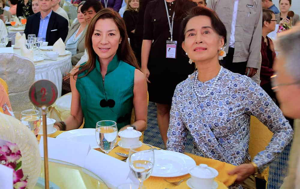 Malaysian actress Michelle Yeoh, left, sits with Myanmar opposition leader Aung San Suu Kyi during the opening ceremony of a special pre-conference in connection with the International Media Conference in Yangon, Myanmar.