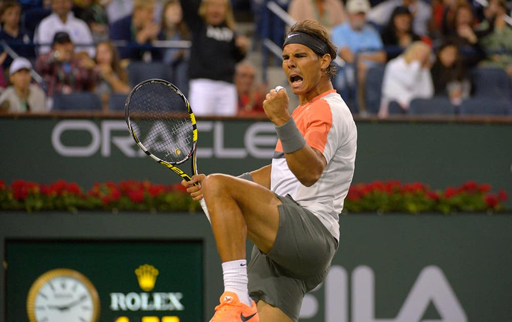 Rafael Nadal, of Spain, reacts to winning a point over Radek Stepanek, of the Czech Republic, in their match at the BNP Paribas Open tennis tournament.