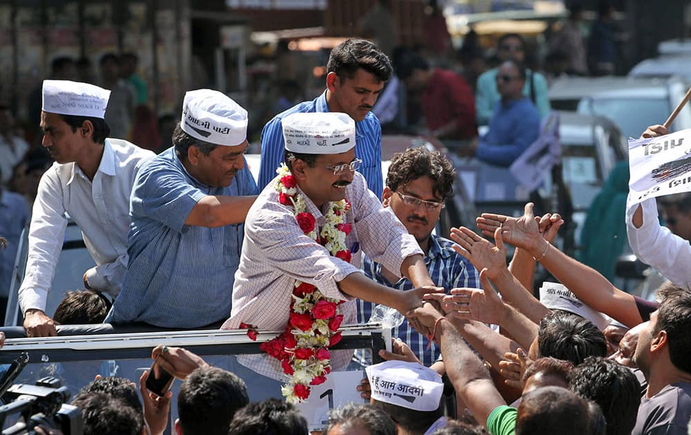 Aam Aadmi Party, or Common Man Party, leader and anti-graft activist Arvind Kejriwal, center, greets supporters during an election rally in Ahmadabad, India.