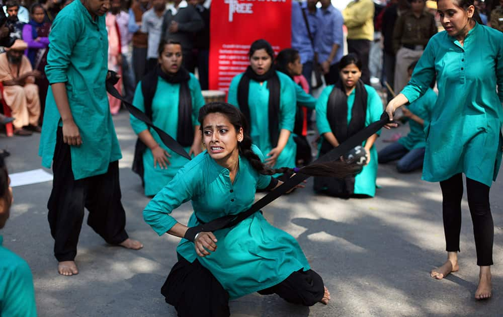A group of college girls perform a street play on violence against women, to mark International Women`s Day in New Delhi.