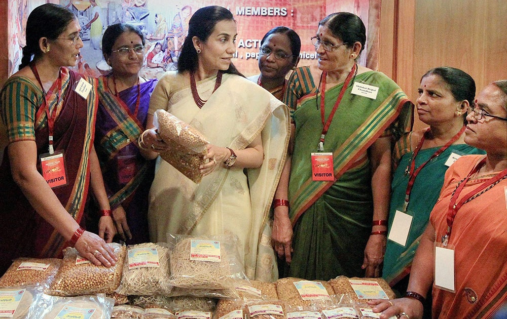 CEO and MD of ICICI bank Chanda Kochhar with women members of a Self Help Group at an event on the occasion of Women`s Day in Mumbai.