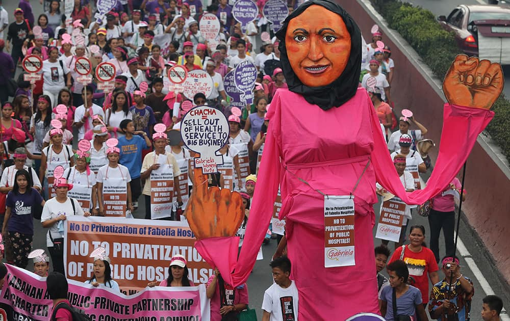 An effigy of a woman is carried by activists as they march towards the Malacanang Palace to mark International Women`s Day in Manila, Philippines.