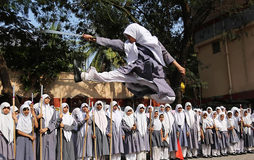 A Muslim girl performs martial arts during a function to mark International Women's Day at a school in Hyderabad. International Women`s Day will be marked on March 8.