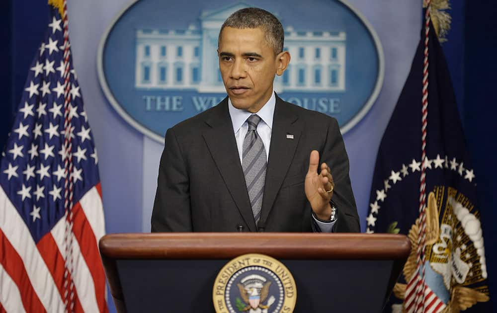 President Barack Obama talks about the situation in Ukraine, in the briefing room of the White House in Washington.
