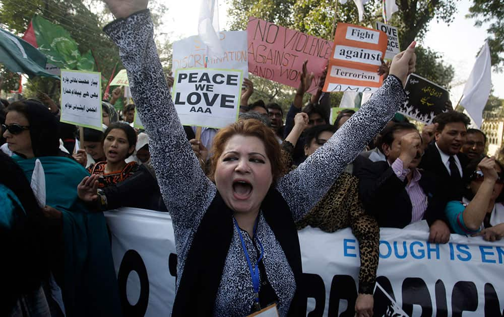 Members of Pakistan`s civil society shout slogans during a protest against terror attacks in Lahore, Pakistan.
