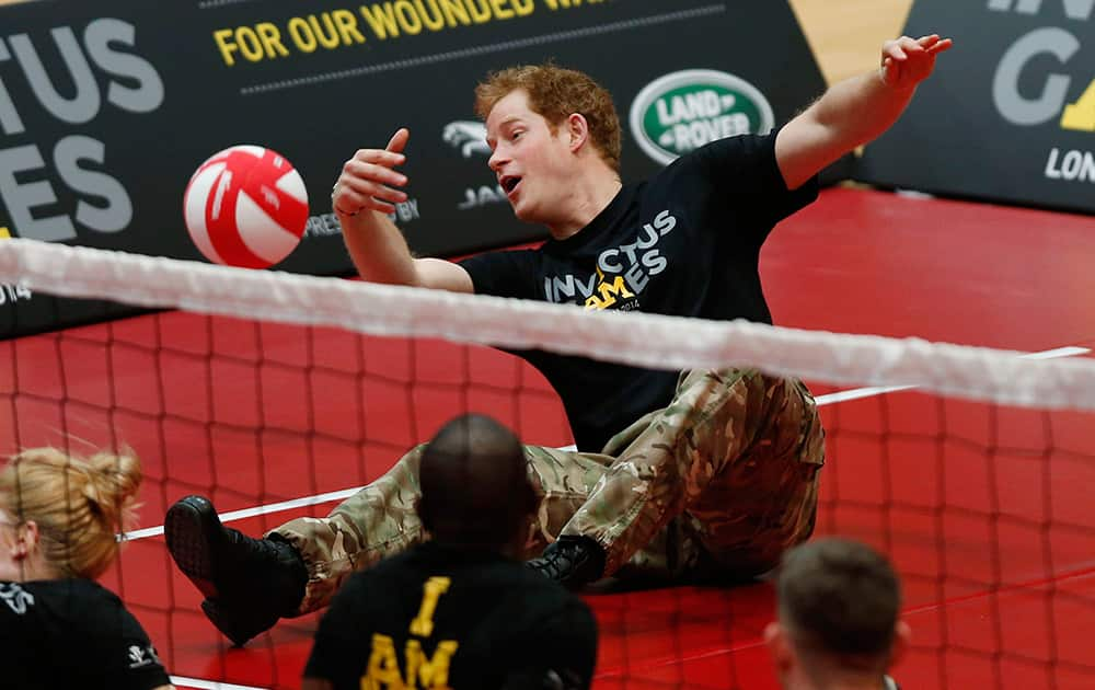 Britain Prince Harry plays a game of sitting volleyball during the launch of the Invictus Games for wounded warriors at the Copper Box arena in the Queen Elizabeth Olympic Park in London.