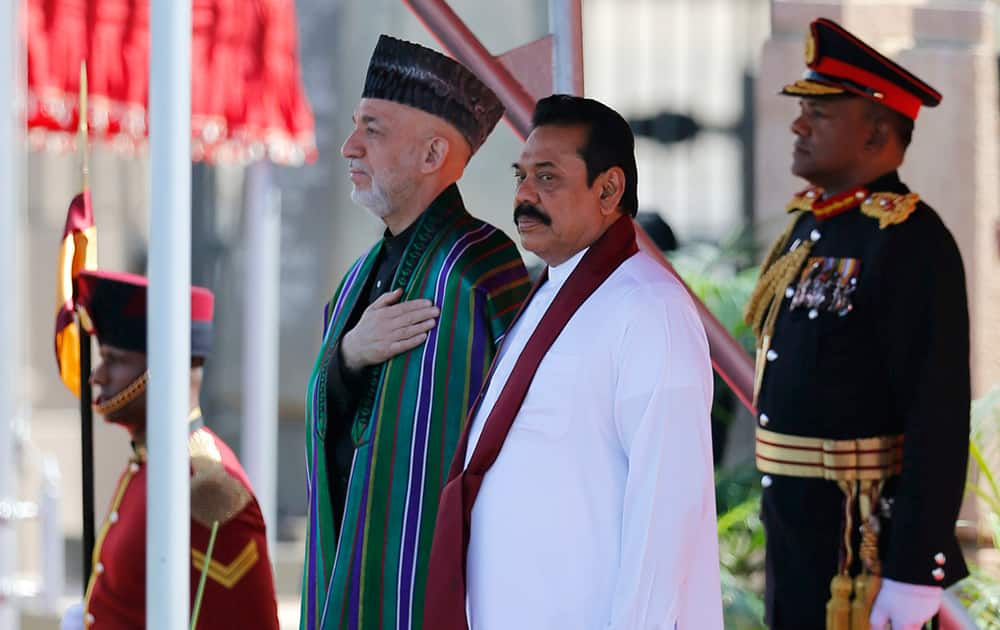 Afghan President Hamid Karzai and Sri Lankan President Mahinda Rajapaksa stand at attention during an official reception for the former in Colombo, Sri Lanka. Karzai is on a three-day official visit to Sri Lanka.