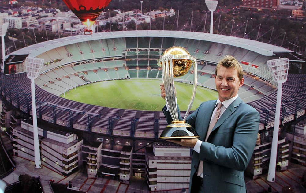Former Australian speedster Brett Lee, holds a replica of the World Cup 2015 trophy during a press conference in New Delhi.