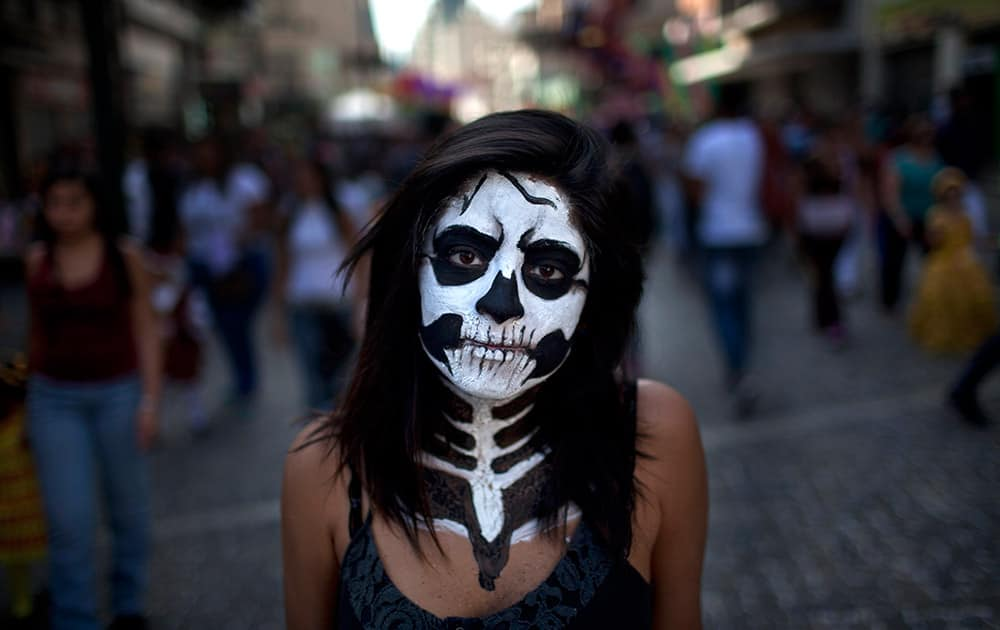 Diana Bochaga, 18, poses for a picture during Carnival celebrations in Caracas, Venezuela.