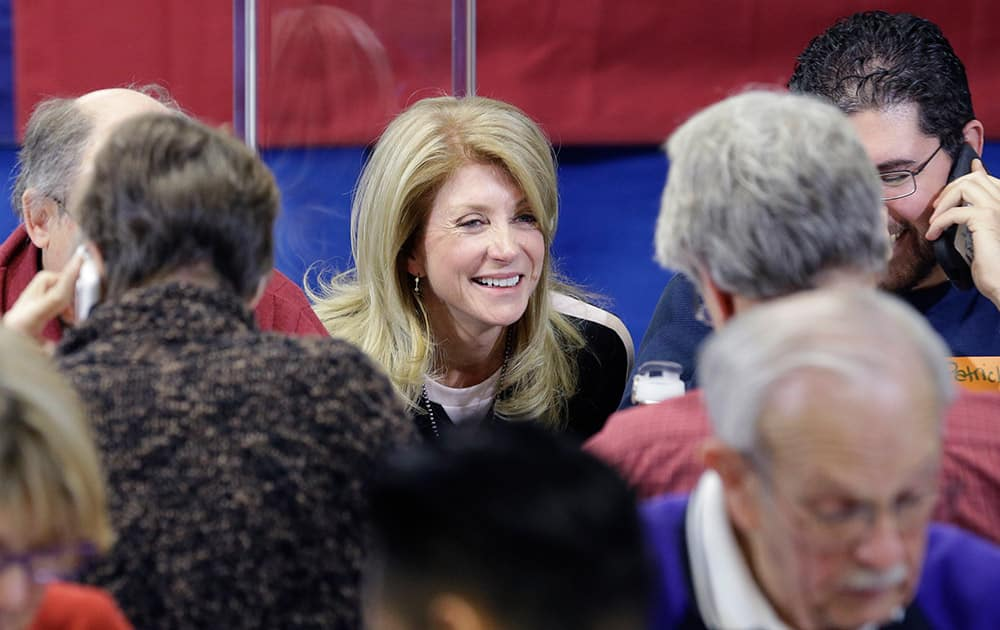 Texas Sen. Wendy Davis, D-Fort Worth, visits with volunteers manning a call center at her campaign headquarters, in Fort Worth, Texas.