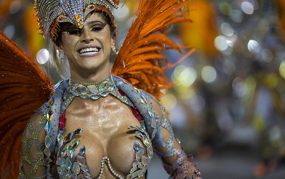 A performer from the Unidos da Tijuca samba school parades during carnival celebrations at the Sambadrome in Rio de Janeiro, Brazil.