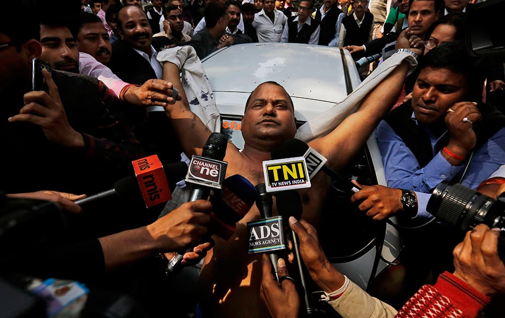 An Indian lawyer is surrounded by the media after he threw ink on Chairman of Sahara India Pariwar Subrata Roy outside the Supreme Court in New Delhi.