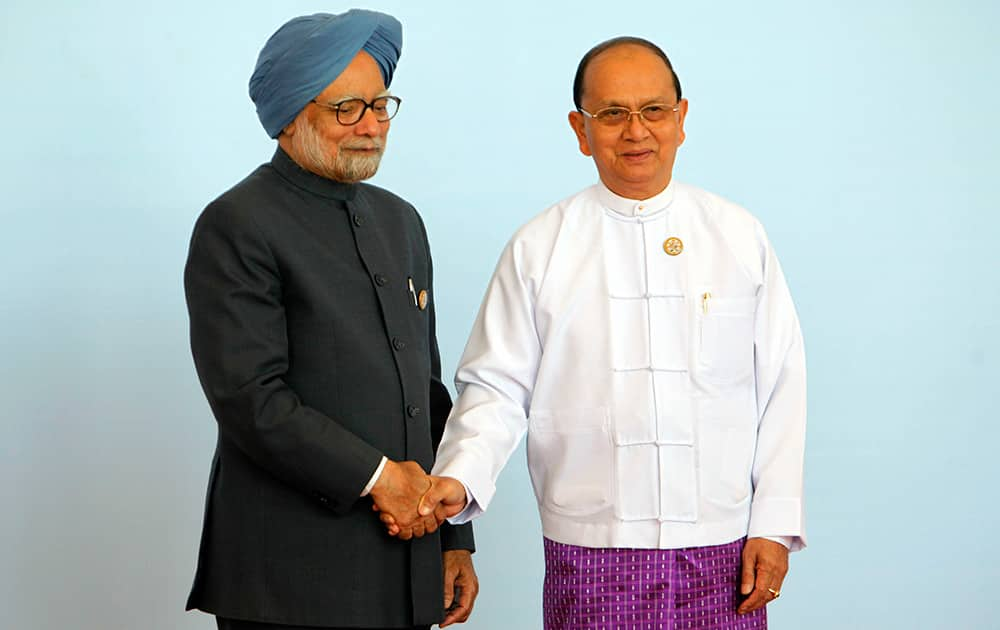 Myanmar President Thein Sein, welcomes India Prime Minister Manmohan Singh during the opening ceremony of the third Bay of Bengal Initiative for Multi-Sectoral Technical and Economic Cooperation (BIMSTEC) summit at Myanmar International Convention Centre (MICC) in Naypyitaw, Myanmar.