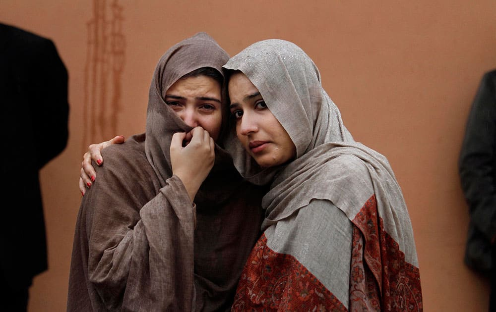 Pakistani women mourn outside a hospital`s morgue, where the bodies of victims of a twin suicide bombing are, in Islamabad, Pakistan.