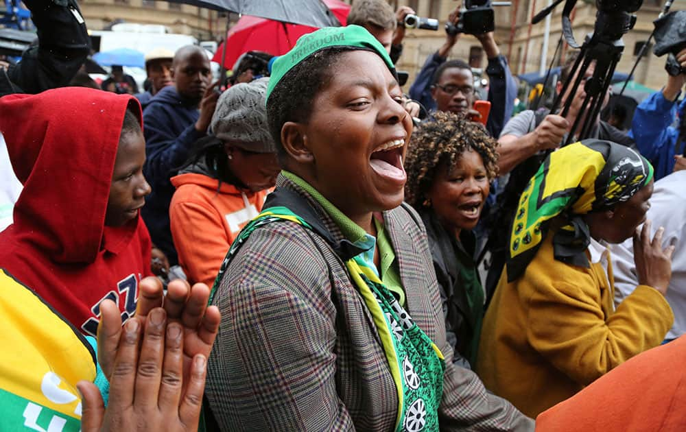 Members of the ANC, African National Congress, protest for woman right`s outside the high court during the trial of Oscar Pistorius in Pretoria, South Africa.
