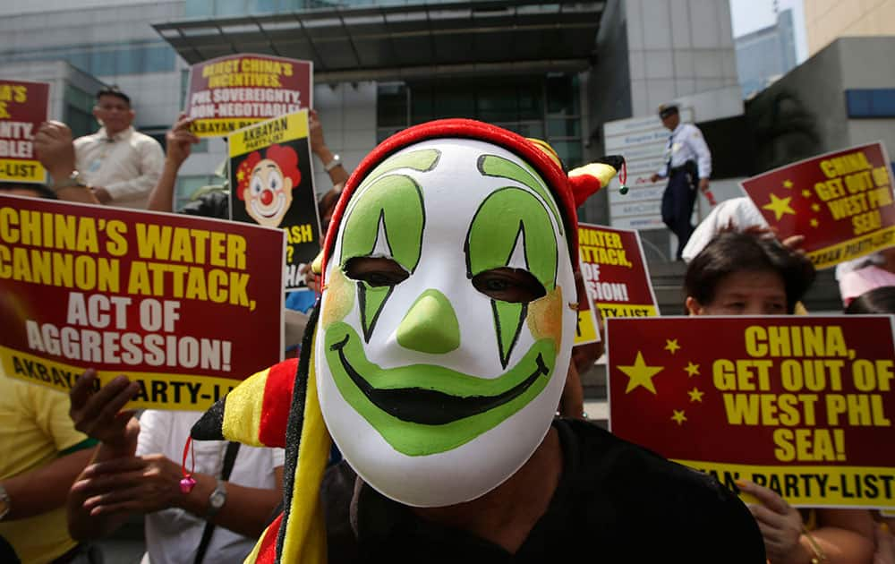 Protesters, some dressed as clowns, picket the Chinese Consulate at the financial district of Makati city east of Manila, to protest the recent use of water cannons by the Chinese coast guard to drive away Filipino fishermen off the disputed Scarborough Shoal in the South China Sea.