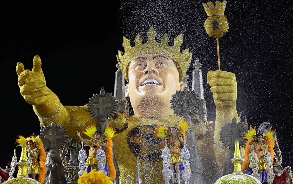 Gavioes da Fiel samba school dancers perform on their float depicting Brazil`s former soccer player Ronaldo wearing a crown at a carnival parade in Sao Paulo, Brazil.