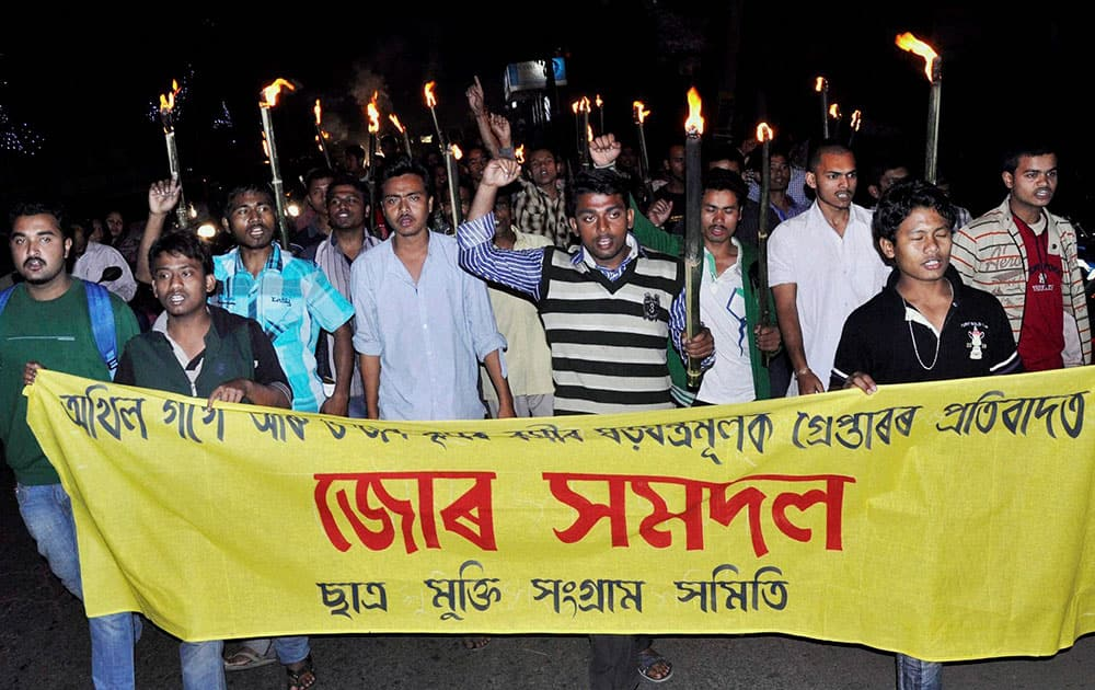 Activists of the Satra Mukti Sangram Samity (SMSS) , a student wing of KMSS take out a torch light procession in Guwahati on Sunday, protesting against the arrest of Krishak Mukti Sangram Samiti (KMSS) President Akhil Gogoi arrested by Assam police from his Nijarapara residences in the wee hours on Sunday.
